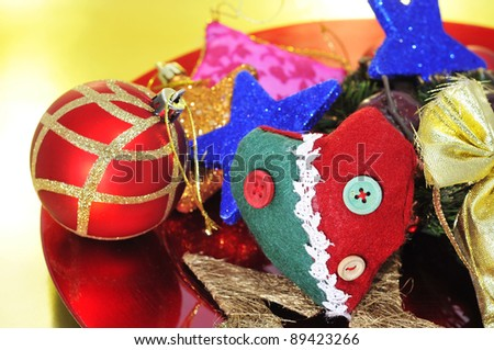 a pile of different christmas ornaments on a red platter