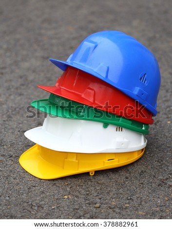 a pile of different colored helmets close up