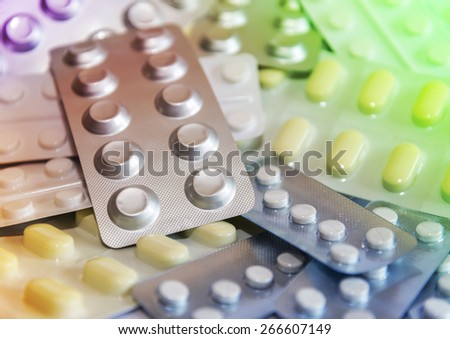 A pile of different medications in blister packs with selective focus - stock photo