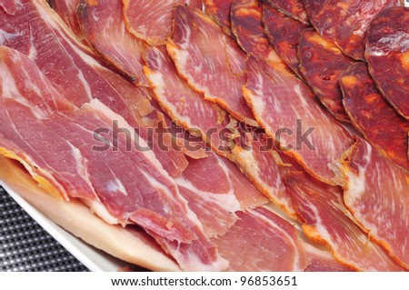 a pile of different spanish embutido, jamon, chorizo and lomo embuchado, typical cold meat - stock photo
