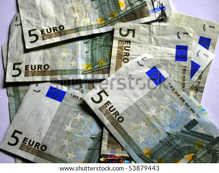 A pile of five euros note paper money.
