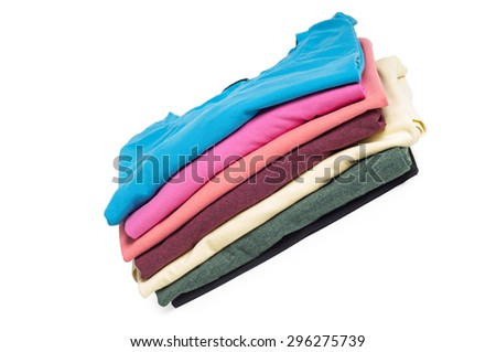 A pile of folded multicolored T-shirts isolated on white - stock photo