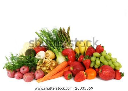 A pile of fresh, healthy fruits and vegetables isolated on white - stock photo