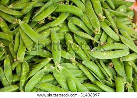 A pile of fresh peas in a street market