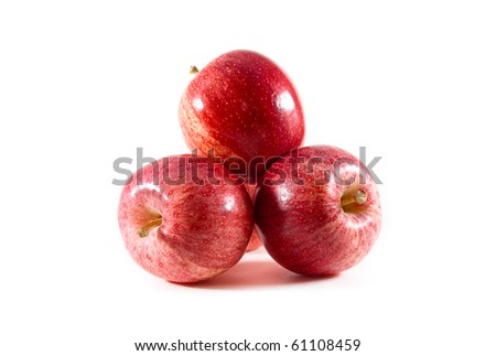 A pile of fresh red and yellow gala apples on a white isolated background. - stock photo