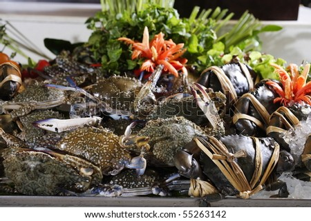 A pile  of fresh sea crabs and ice - stock photo