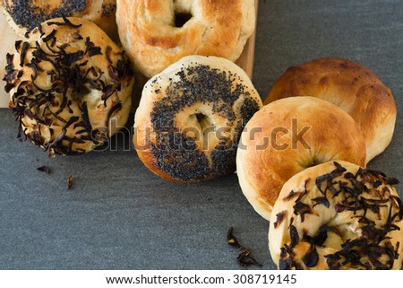 A pile of freshly baked homemade bagels. These mouth-watering delights would be wonderful for advertisements, magazines, bakeries, restaurants, grocery stores, flour companies, or hang on the wall. - stock photo