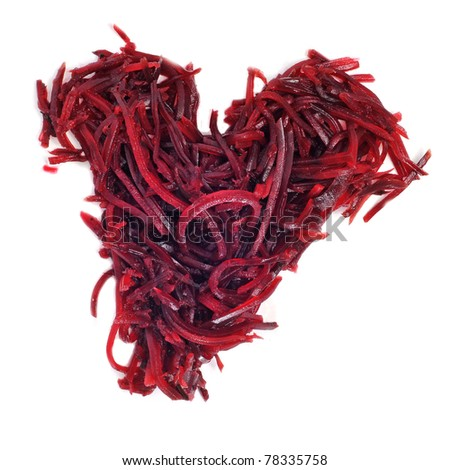 a pile of grated beet forming a heart on a white background