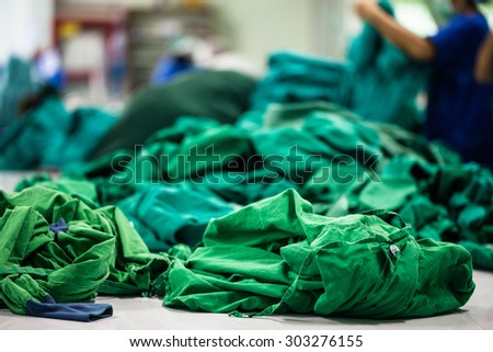 A pile of green cloth for  the operating room. - stock photo
