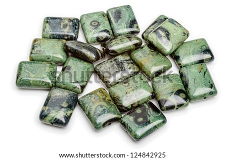 A pile of green jasper puffed rectangle beads. - stock photo