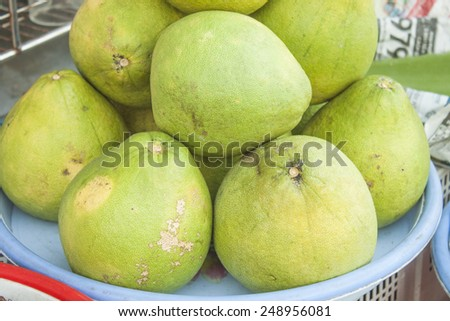 A pile of green pomelo, at a market - stock photo