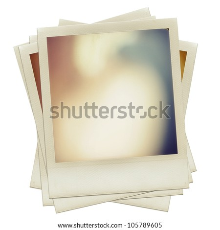 A pile of grungy blank instant film frame with abstract  color filling, isolated over white background, vintage hard grain effect added - stock photo