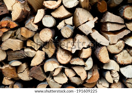 A pile of hard fire wood fence background