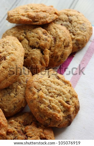 A pile of Homemade chocolate and nut cookies - stock photo
