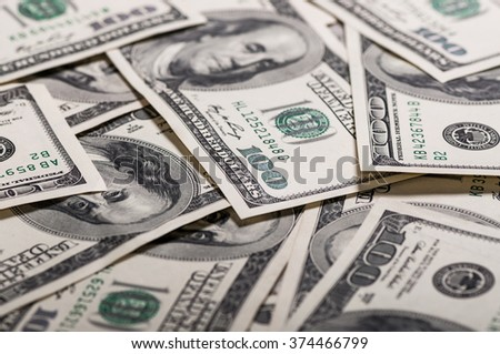 A pile of hundred dollar bills - stock photo