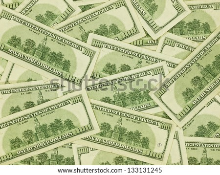 A Pile of Hundred Dollar Bills Face Down as a Money Background - stock photo
