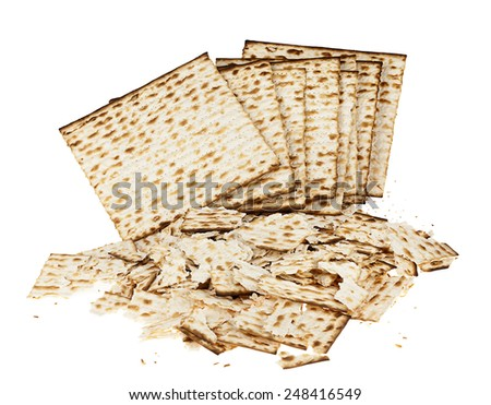 A pile of intact and broken pieces of Jewish Matzah bread, the substitute for bread on the Jewish Passover holiday, isolated on white background. - stock photo