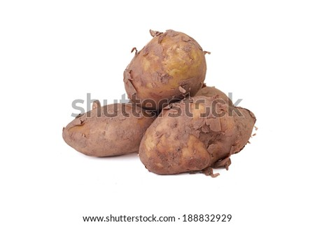A pile of Jersey Royal potatoes isolated on a white background. - stock photo