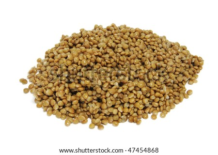 a pile of lentils isolated on a white background