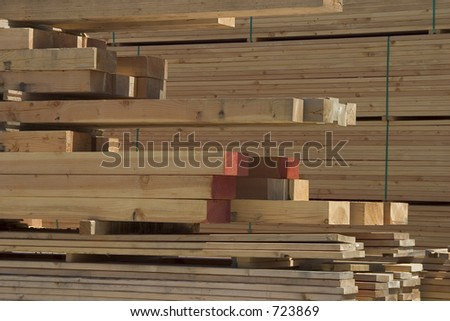 A pile of lumber at a lumberyard.