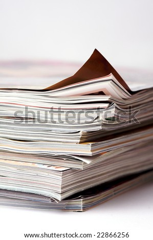 a pile of magazines - stock photo