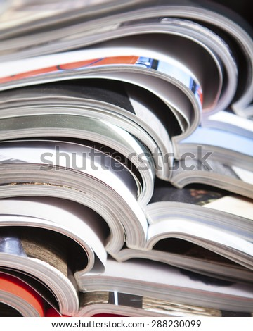 a pile of magazines close up - stock photo