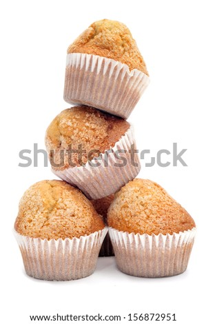 a pile of magdalenas, typical spanish plain muffins, on a white background - stock photo