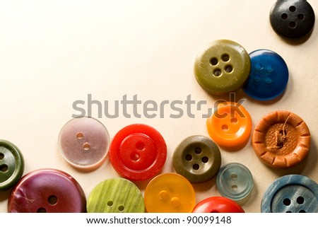 A pile of many-coloured buttons - stock photo