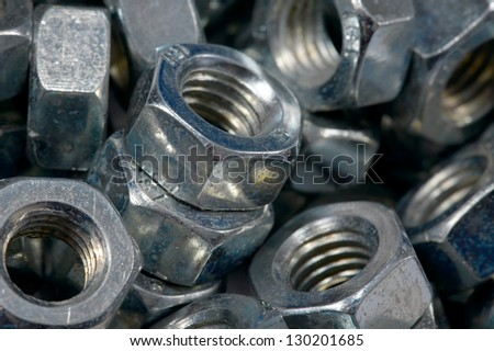 A pile of metal nuts - stock photo