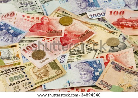 A pile of mixed foreign currency including US, Taiwan, Indian, Hong Kong, Honduran, Malaysian and Korean currency