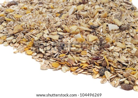 a pile of muesli on a white background - stock photo