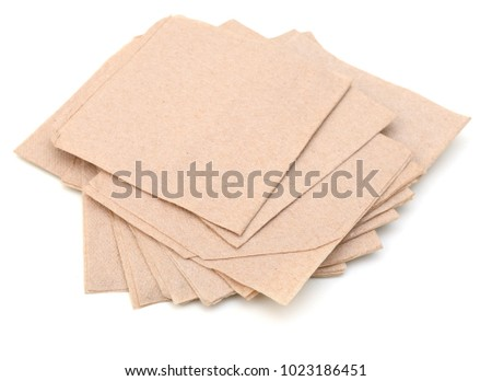 A pile of napkin recycled papers on white