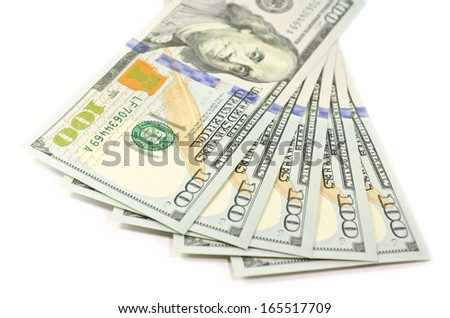 A pile of new isolated 2013 hundred dollar bills, isolated on white background with soft focus - stock photo