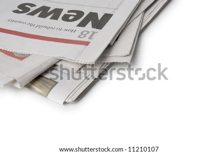 A pile of newspapers isolated on white. The news headlines are at the top of the pile. See more newspaper images in my gallery.