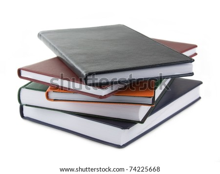A pile of notebooks isolated over white - stock photo