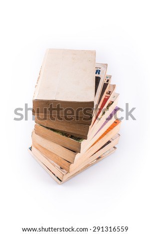 A pile of old books. - stock photo