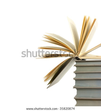 A pile of old books and the one open at top, copyspace, isolated over white - stock photo