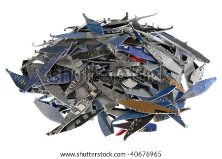 a pile of old expired credit card shredded, isolated on white - protection against identity theft concept - stock photo