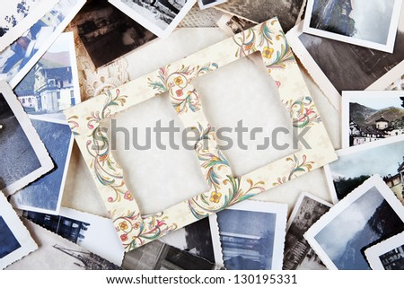 A pile of old photographs with space for your logo or text. - stock photo