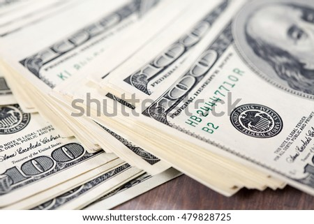 A pile of one hundred US dollar bills