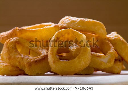 A pile of onion rings - stock photo