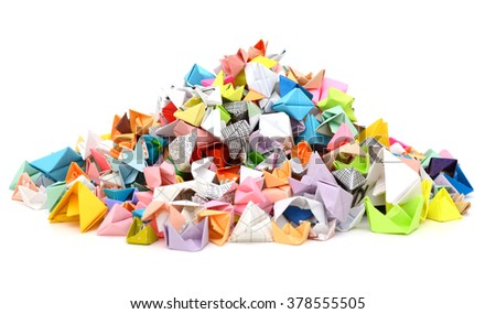 A pile of origami paper boats - stock photo