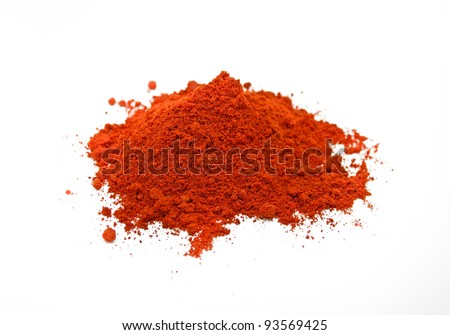 A pile of paprika spice on a white background