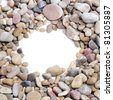a pile of pebbles forming a frame on a white background - stock photo