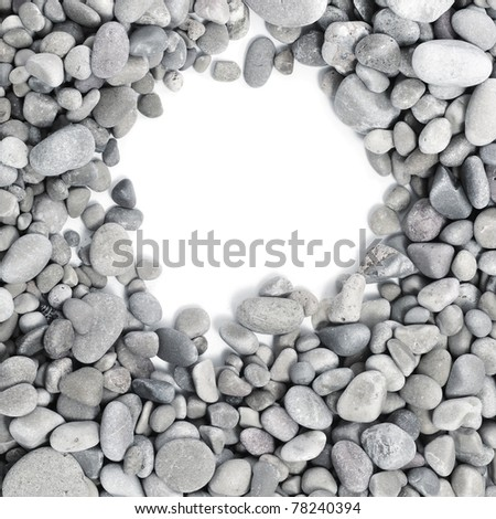 a pile of pebbles on a white background as a frame - stock photo