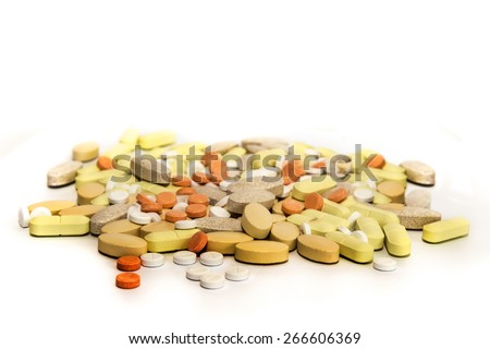 A pile of pills and tablets - stock photo