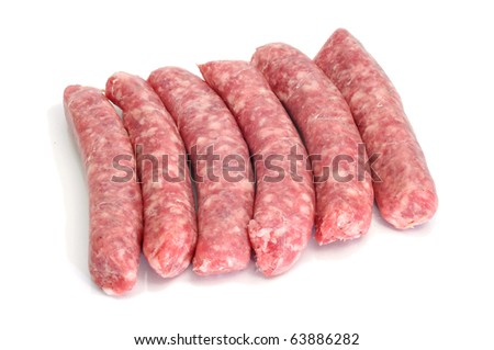 a pile of pork meat sausages isolated on a white background