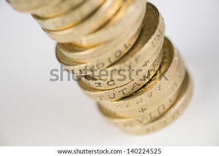 A pile of pound coins on a table. - stock photo