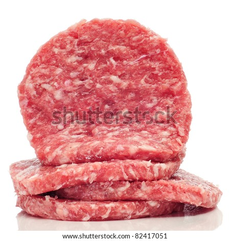 a pile of raw burgers on a white background - stock photo