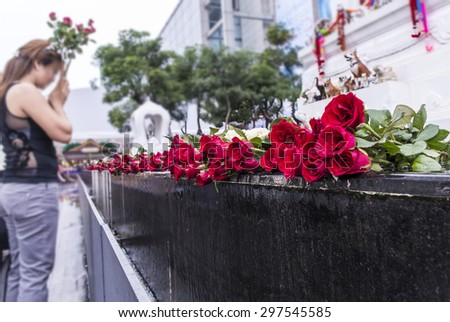 A pile of red roses for worship at pool side - stock photo